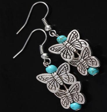 Oorbellen Butterfly kisses en turqoise